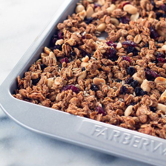 Almond butter and maple syrup are poured over rolled oats, and baked into a chunky granola that is bursting with flavor!