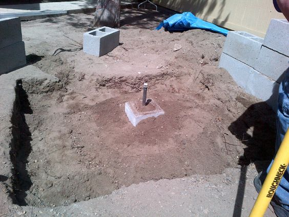 We dug the hole to the size we wanted and secured the gas pipe by surrounding it with a half cement block and filled it in with dirt.