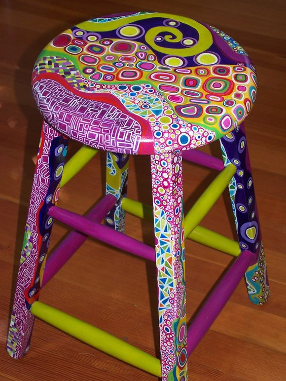 Paint a wooden stool with acrylic paints...get creative...so cute! :)  For those kindergarten chairs I've been saving.: