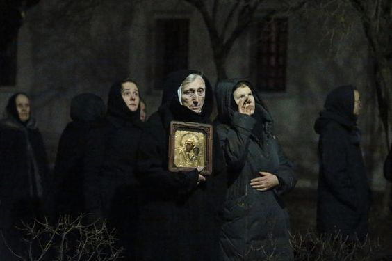 Orthodox nuns watch firefighters work to extinguish a fire at the bell tower of Novodevichy monastery, a UNESCO World Heritage site, in Moscow
