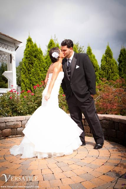 The Versailles Ballroom offers a beautiful outdoor space with lush trees, flowers, and a gazebo. It is the perfect location to take some romantic formal photos. www.VersaillesCaterers.com. Photo courtesy of Versatile Event Designs.  #NJWeddings #WeddingsNearTomsRiver #VersaillesBallroom #WeddingsNearJerseyShore #Bride #Groom #Weddings #CentralNJWeddingVenue #NJWeddingVenue #WeddingPhotography #NJBanquetHall #NJWeddingVenue #Ramada #JerseyShoreWeddings