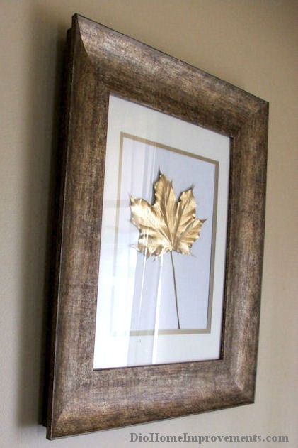 Gold Painted Leaves....This project was so easy! I had the frames and gold paint already on hand. I used one red oak, one white oak and one maple leaf from my yard. All i did was paint the leaves gold and when they were dry I framed them!