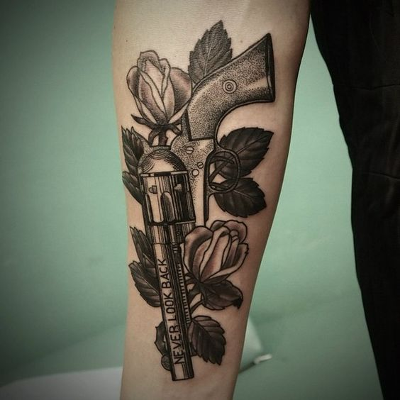 Revolver tattoo by oleg barrymore http tattoos - Tatouage pistolet femme ...