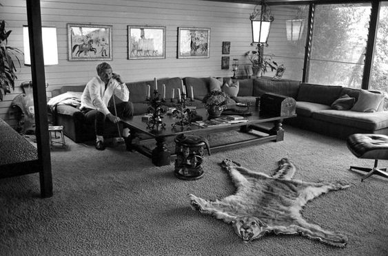 """McQueen takes a call in the living room of his eclectic home in Hollywood. """"Man, if I didn't make my own scene, I could have wound up a hood instead of an actor,"""" he told LIFE at the time, reflecting on a rough-and-tumble past that included a stint in a school for problem kids and 41 days in the brig for going AWOL while in the Marines."""