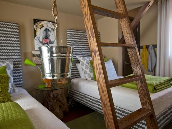 From HGTV's 2012 Green Home- there are several things I don't like about this room but the idea of the blocky bed frame being wrapped in the same fabric as the headboard is really cool