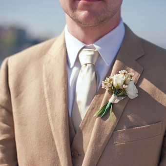 J.Crew suit and boutonniere of spray roses and wax flowers. Photo by Weber Photography; Floral design by Bloom Floral Design Studio #weddings