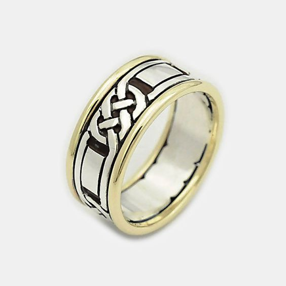 A Celtic knot ring, perfect Mens celtic wedding rings - Two Tone ringmade of Silver and gold  with Celtic Oxidized Design and Solid 9ct Gold Rims    Perfect for a Father's day gift , Anniversary Ring, Graduation Gift    Dimensions:  Width: 12mm  Weight: 12 grams    Metal: 9ct Gold & Sterling Silver  KDSR    The Ring comes in a pretty box ready for giving as a gift.  FREE EXPRESS SHIPPING!!!    Come see more mens rings…