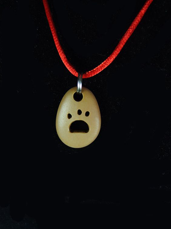 Drilled Beige Beach Stone Pendant with Carved Paw by Sisyen