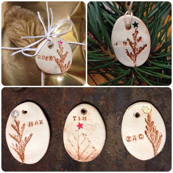 """Leaf impression name tags... white clay with with twigs & leaves to make impressions. The paint effect is done by painting the impressions thickly then wiping all the paint off with a wet cloth - from Kindling: Playwork, Training, Forest Schools and creative workshops ("""",)"""