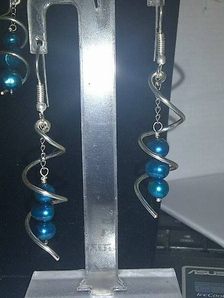Twirl earrings with cultured pearl drops