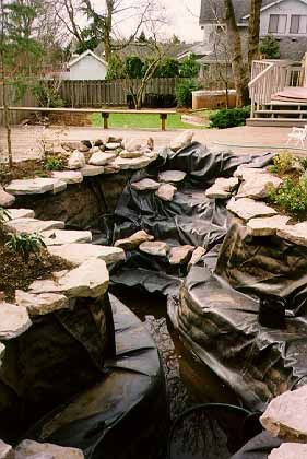 Earthbag building swimming pool converted into a pond for Koi pond swimming pool conversion