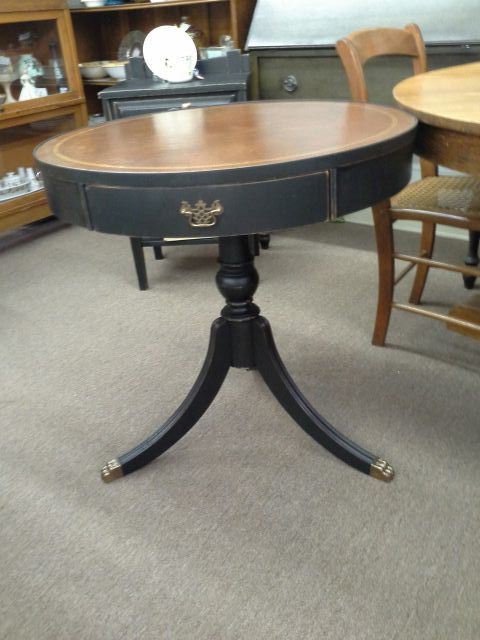 $69 - This three-legged Duncan Phyfe style drum table has a single drawer and a leather table top. The table has been painted black and lightly distressed. Finished with a tinted wax. The table is 28 inches in diameter and stands 28 inches tall. It can be seen in booth A 6 at Main Street Antique Mall 7260 East Main St ( E of Power Rd ) Mesa 85207  480 9241122open 7 days 10 till 530 Cash or charge accepted