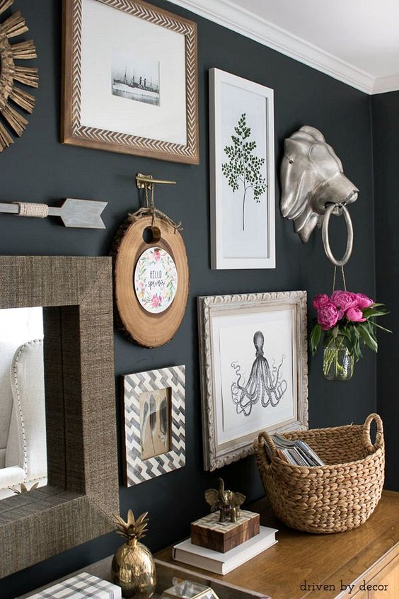 Eclectic gallery wall - love that lion head door knocker!