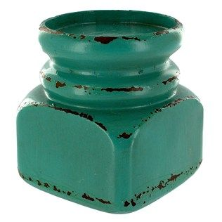 "Showcase your favorite scented or flameless LED candle on this Small Aqua Distressed Block Candle Holder. Display it alone or nestle the candle holder among other similar decorative pieces to enhance décor.    	Dimensions:    	  		Length: 3 3/4""  	  		Width: 3 3/4""  	  		Height: 4 1/8""  	  		Candle Display Holder Diameter: 3 1/8"""