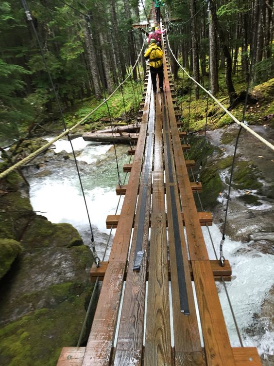 Snapping a picture with one hand on a wobbly, wet suspension bridge over a rushing waterfall...no problem :)