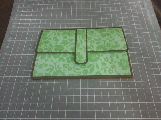 Pocketbook style scrapbook closed with shipping tag inserts inside by Raz & Dazzle Ink