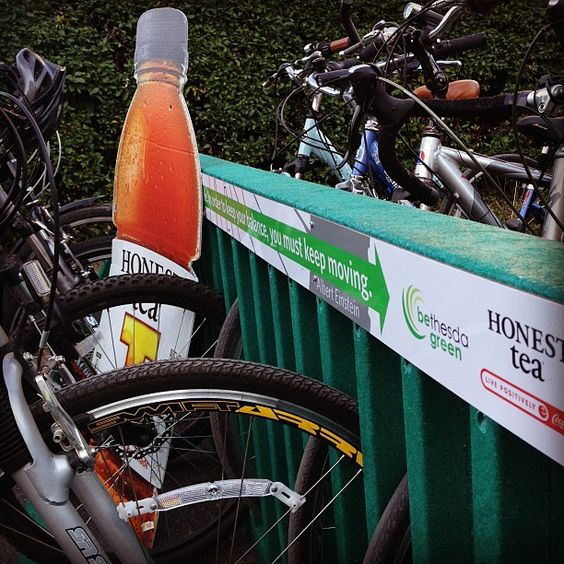 """Check out our new bike racks made from 15,000 recycled Honest Kids juice pouches! Pretty cool!"""