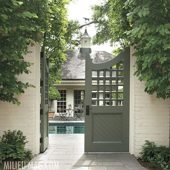 Garden gate inspiration: Latticework-patterned wooden gates, which open to a pool and pool house.#gardengate #poolhouse #summerstyle #lattice