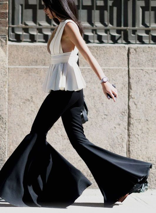 HOW TO WEAR EXTRA FLARED PANTS Street Style | Runway | Editorials Shop Featured Flare Pants at Net-a-Porter MatchesFashion