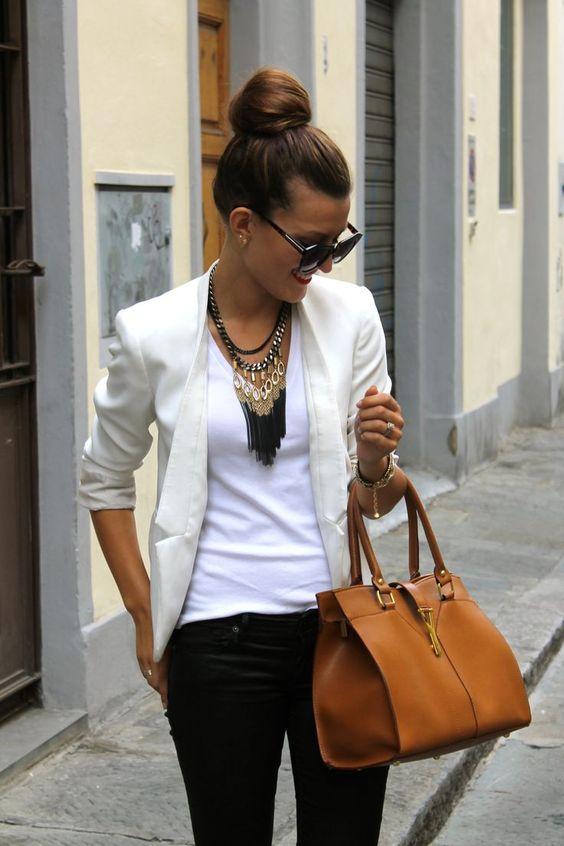 Shop this look on Lookastic:  http://lookastic.com/women/looks/sunglasses-necklace-v-neck-t-shirt-bracelet-blazer-satchel-bag-skinny-jeans/8450  — Black Sunglasses  — Black Necklace  — White V-neck T-shirt  — Gold Bracelet  — Beige Blazer  — Tobacco Leather Satchel Bag  — Black Skinny Jeans:
