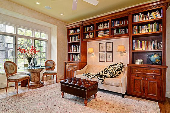Custom built-in bookshelves with a cozy reading niche in the center.