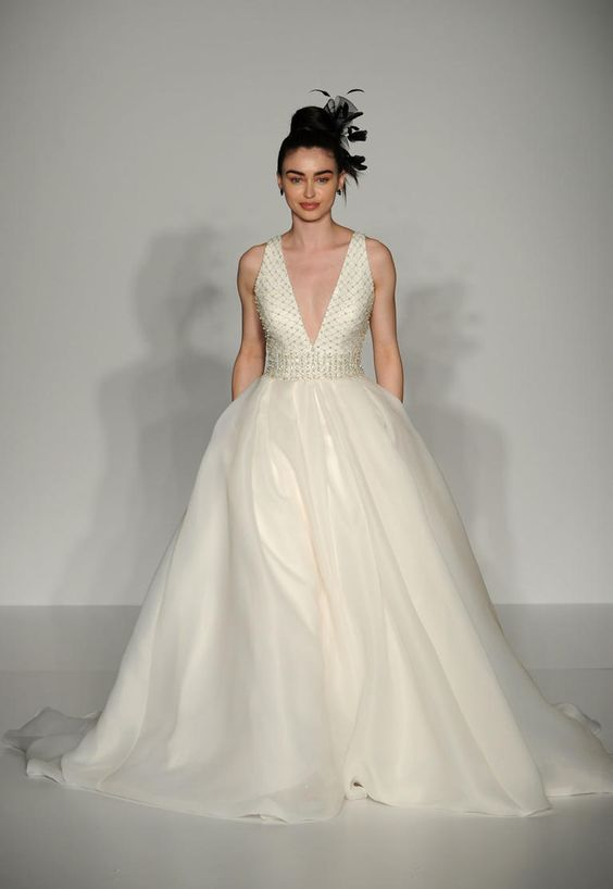 Embellished ball gown with beaded bodice and plunging neckline #weddingdress