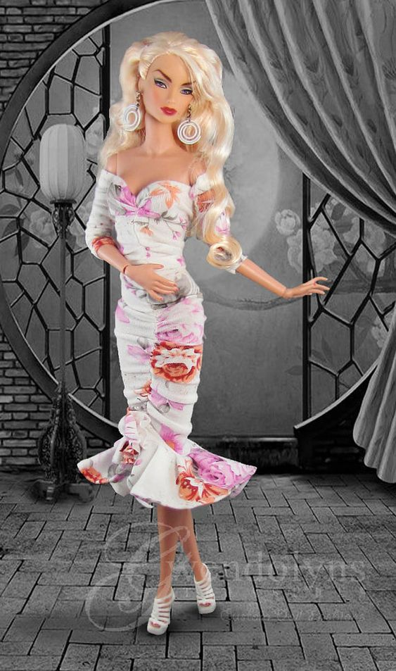 Feminine floral print knit for 11 - 12 dolls. Slip on ruched halter dress with…