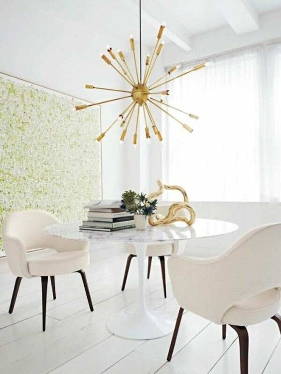 interior design mid century Hollywood regency dining room tulip table with marble top sputnik brass pendant lamp light chandelier white floors and upholstered chairs