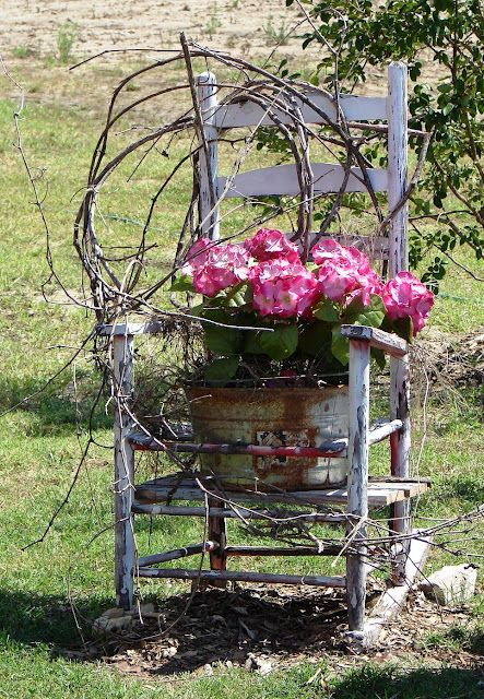 Weathered Prim Chair...with old tub filled with flowers.  thecountryfarmhouse.blogspot.com