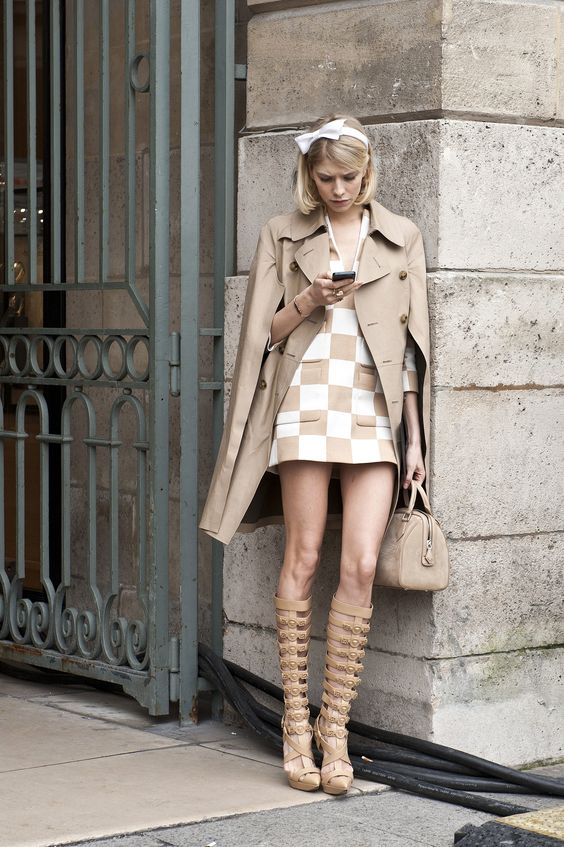 Elena Perminova juxtaposed her sweet style on top with gladiator-style sandal boots. #streetstyle