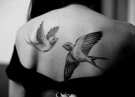 white and black ink bird tattoo