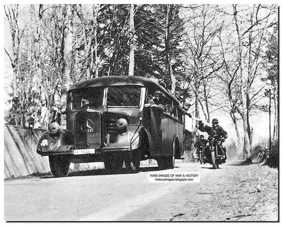 SS Totenkopf men in the bus give a some document to a motorcycle rider