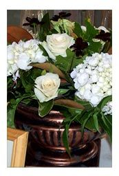 Simple pallete of flowers... but the vessel really makes this arrangement gorgeous.