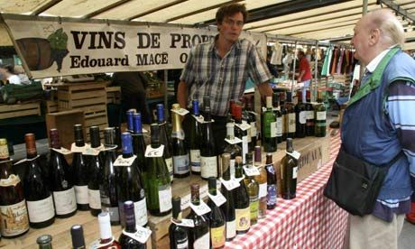 Selling wine at Marché Richard Lenoir in Paris. Some for the home wine cellar perhaps?
