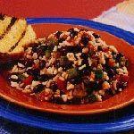 Moros y cristianos - Ingredienti per 4 persone  500 g. di riso lungo  250 g di fagioli neri messicani  1 peperone rosso   1 cipolla media  2 spicchi d'aglio  1 cucchiaio di cumino   1 cucchiaio di origano  1,5 l d'acqua  olio extra vergine di oliva  sale