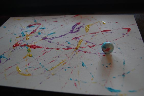Simple project. Dip marbles in cups of paint. Tape down a piece of paper to a cookie sheet and ROLL!