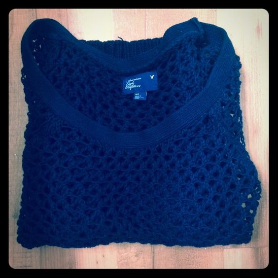 American Eagle Black Knit Sweater Very cute black sweater. Can also be used as a swim suit cover up and is great for layering different shirts and colors. Size is S but runs a little big so it can also fit as M. American Eagle Outfitters Tops Tunics