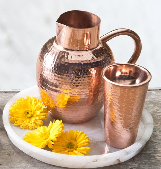 BED SIDE AYURVEDA The benefits of storing water in copper vessels has been part of human history for millennia. The ancient wisdom of #Ayurveda suggests that water stored overnight in copper vessels has the ability to balance all the three 'doshas' in the body by positively charging the water. The Ganges Jug & Tumbler are ideal for the bedside or workspace, where water is kept for hours at a time. Shop the collection on our #WebBoutique #Nourish #Ayurveda #Copper #BridalWishList