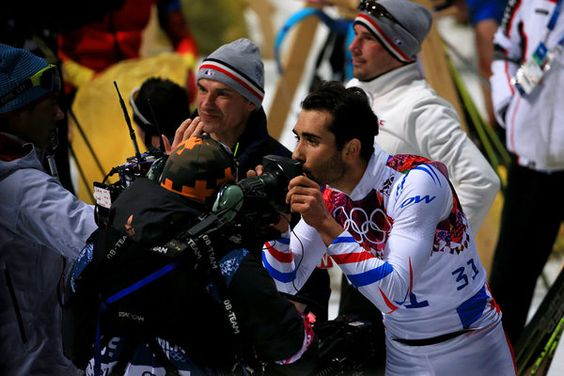 SOCHI, RUSSIA - FEBRUARY 13: Martin Fourcade of France kisses a TV camera as he celebrates after the Men's Individual 20 km during day six of the Sochi 2014 Winter Olympics at Laura Cross-country Ski & Biathlon Center on February 13, 2014 in Sochi, Russia. (Photo by Richard Heathcote/Getty Images)