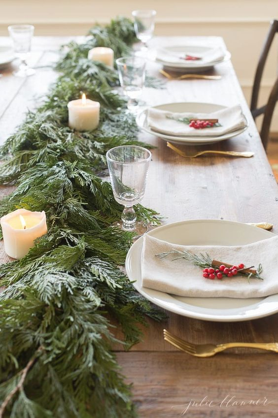 The best Christmas table decor ideas that'll make your Christmas table look amazing! You can easily create these Christmas table settings in your own home! Pinning these whimsical Christmas table decorations for later! #joyfullygrowingblog #christmastable #christmastablescape #christmasdecor