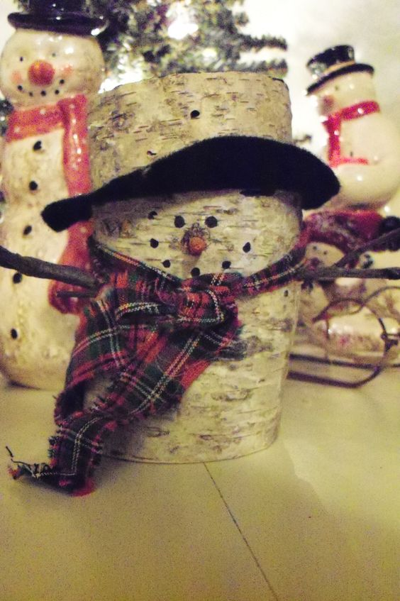 One of my favorites a little snowguy made from a birch for White birch log crafts