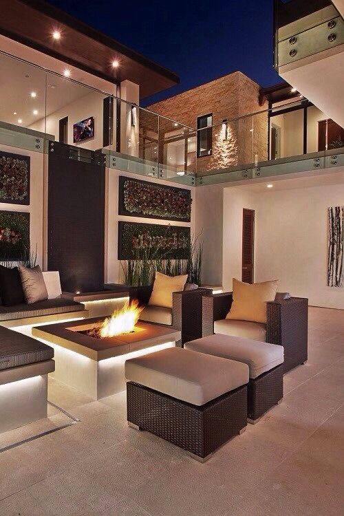 sophisticated luxury outdoor space with fireplace - Modern Luxury Homes Interior Design