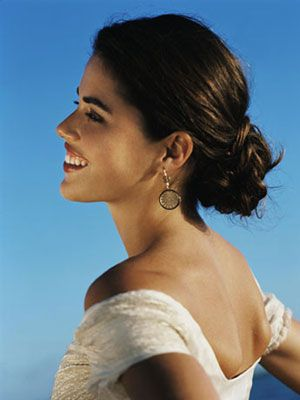 Romantic, Elegant, Beautiful. Sophisticated. These are all words associated with the simple beauty of a low bun.