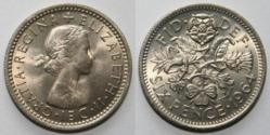 The Sixpence was similar to a dime,they changed the coinage to a whole new, more simple system after we left the UK