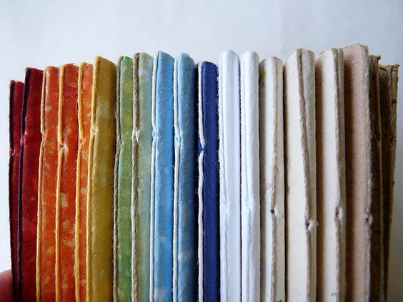 A rainbow of pamphlet stitch books by immaginacija, via Flickr