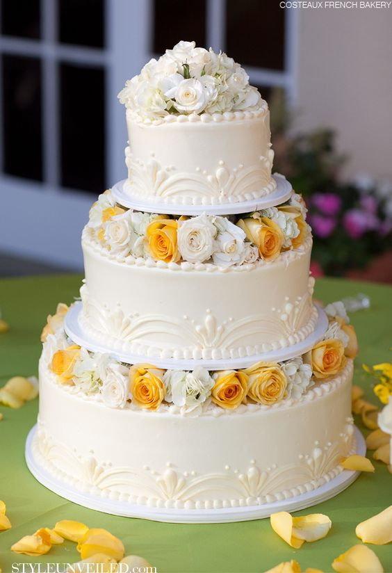 Yellow Rose Wedding Cake  Designed by Costeaux French Bakery  Love the simple beauty
