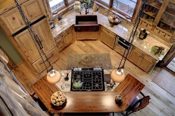 This rustic style is definitely unique and provides a great look. It's a smaller kitchen, but it's definitely nice and perfect for a cabin style kitchen with the large island.