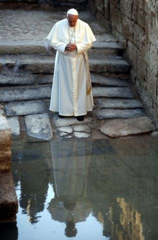 Pope Francis prays as he visits Bethany, a site on the eastern bank of the River Jordan where some Christians believe Jesus was baptised. May 2014.: