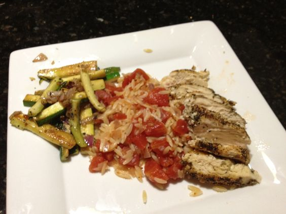 blackened chicken with spicy tomato orzo and grilled zucchini