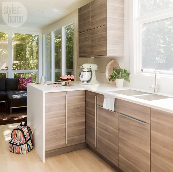 A dark, traditional kitchen gets a light and bright renovation with some serious sleek modern style.